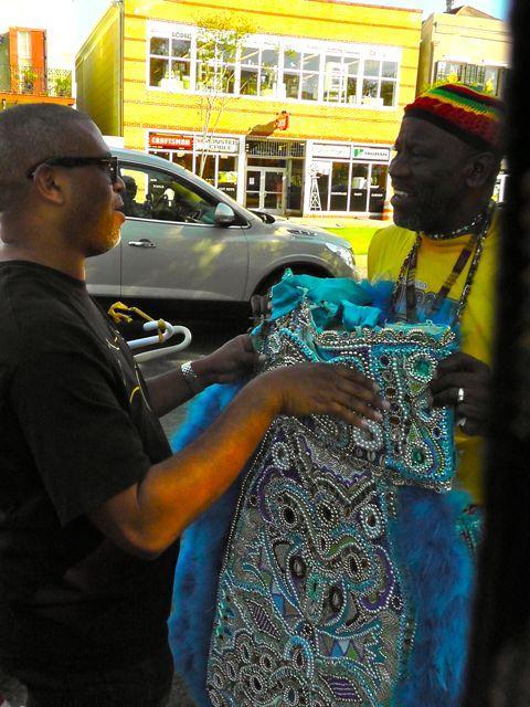 Reginald & Big Chief Fi Yi Yi holding costume