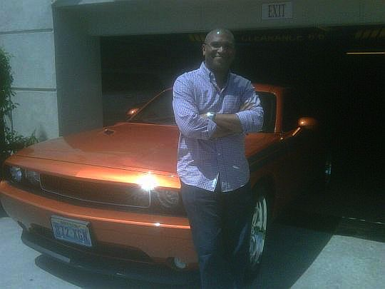 Reggie with red Dodge Challenger