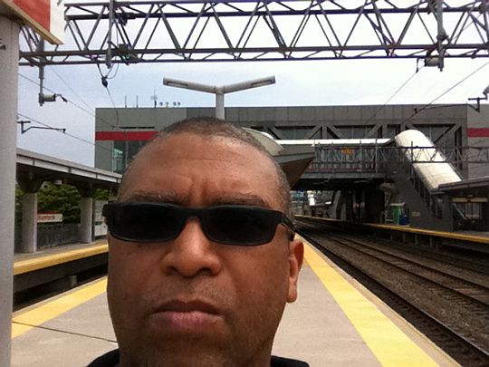 Reggie at Train station at Stamford
