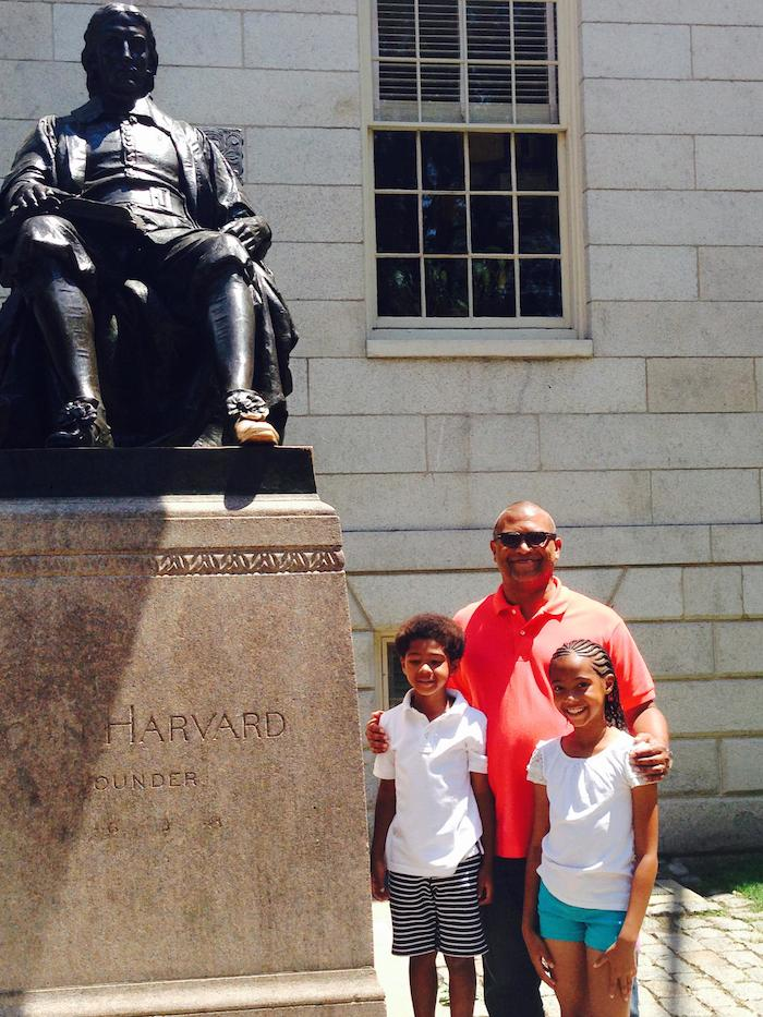 Reggie w/children at Harvard statue