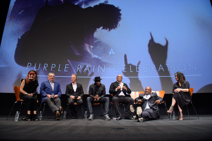 "The Academy presented a screening of ""Purple Rain"" on Wednesday, August 17, 2016. Pictured (left to right): Marie France, Robert Cavallo, Albert Magnoli, Apollonia Kotero, Marcus Miller, Reginald Hudlin, Jerome Benton and Jill Jones. ©AMPAS"
