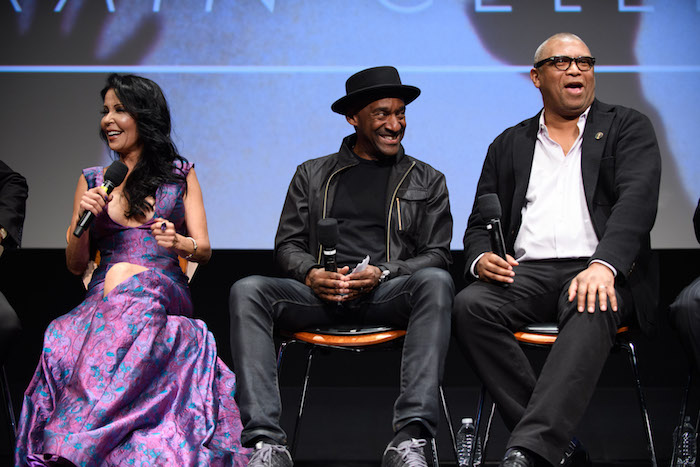 "Actress/musician Apollonia Kotero (left), moderator Marcus Miller (center) and Academy governor/moderator Reginald Hudlin prior to a screening of ""Purple Rain"" presented by the Academy of Motion Picture Arts and Sciences, on Wednesday, August 17, 2016."