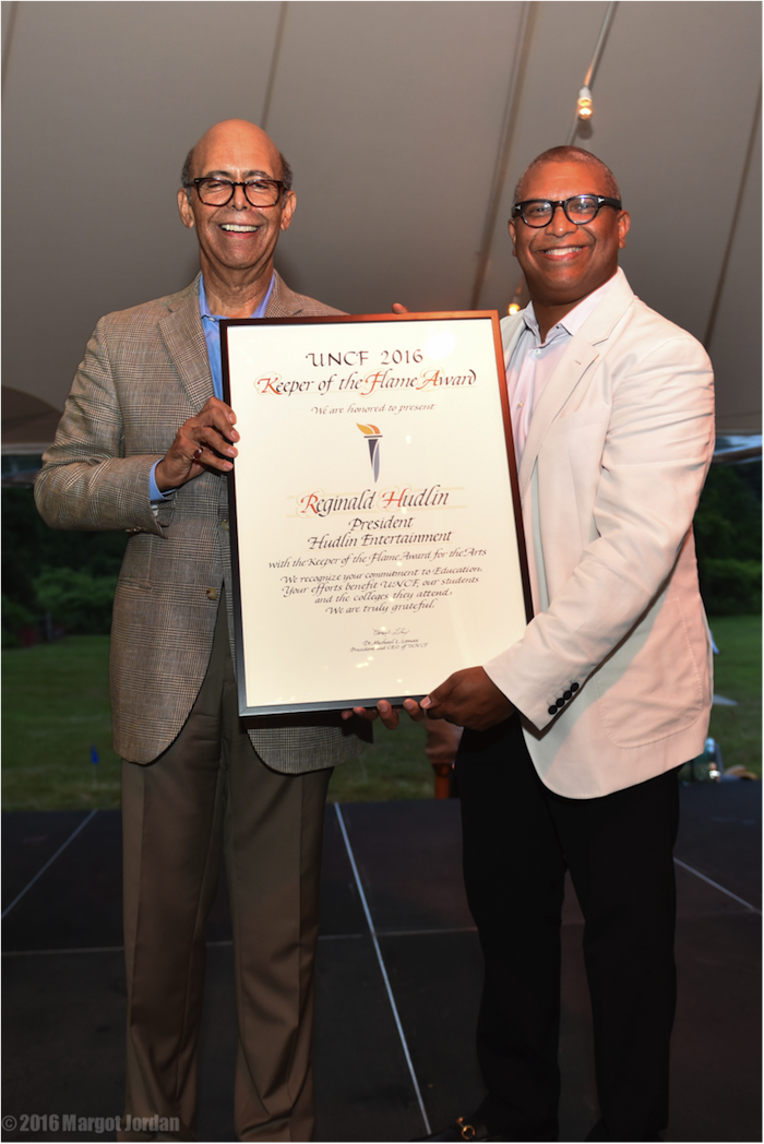 Dr. Michael Lomax, President of the UNCF, presents me with a huge plaque!